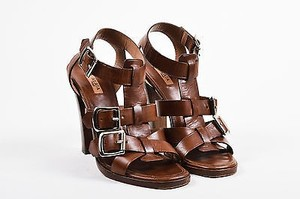 ALAÏA Alaia Leather Wooden Chunky Heel Cage Buckle T Strap Brown Sandals