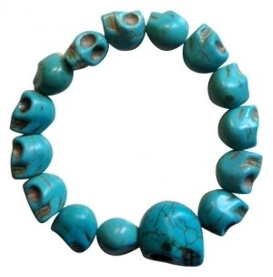 Preload https://item5.tradesy.com/images/urban-outfitters-turquoise-stretch-skull-bracelet-180634-0-0.jpg?width=440&height=440