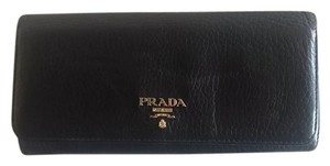 Prada Prada Pebbled Leather Wallet.