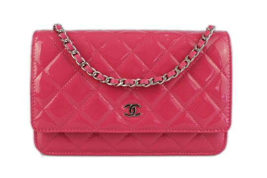 Preload https://item3.tradesy.com/images/chanel-wallet-on-chain-quilted-pink-patent-leather-cross-body-bag-1809082-0-6.jpg?width=440&height=440