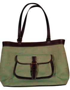 Dooney & Bourke Tote in Light Green Background w/ Brown Leather Trim And Straps