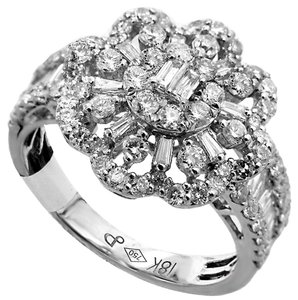 ABC Jewelry 1.68 ct diamond right hand ladies ring. All 18kt white gold set with genuine baguettes and round diamonds with a total weight of 1.68ct, measure 15mm wide and graded G-Color and SI2-Clarity, GORGEOUS SKU: 1000583185