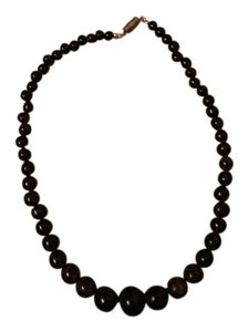Free gift with purchase. Brown and black swirl beaded necklace