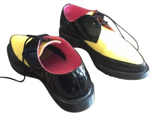 Dr. Martens Yellow and black Flats
