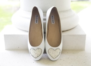 Heart Design With Sparkles And Pearls. Wedding Shoes