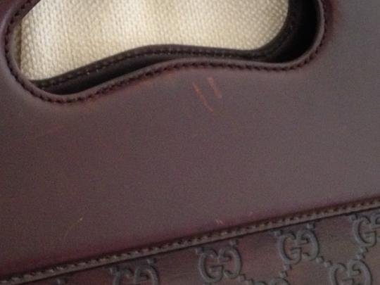 Gucci Guccisima Leather Executive Gold Horse Bit Logo Signiture Print Lining Punch Top Tote in Chocolate Brown