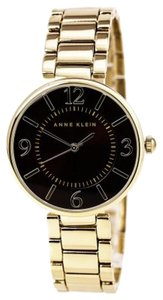 Anne Klein Anne Klein(R) Polished Goldtone Bracelet Watch with Brown Sunray Dial