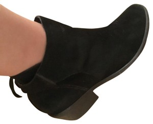 Schutz black suede booties. Worn.. Side zipper with 1 inch heel and ties in back as shown Boots