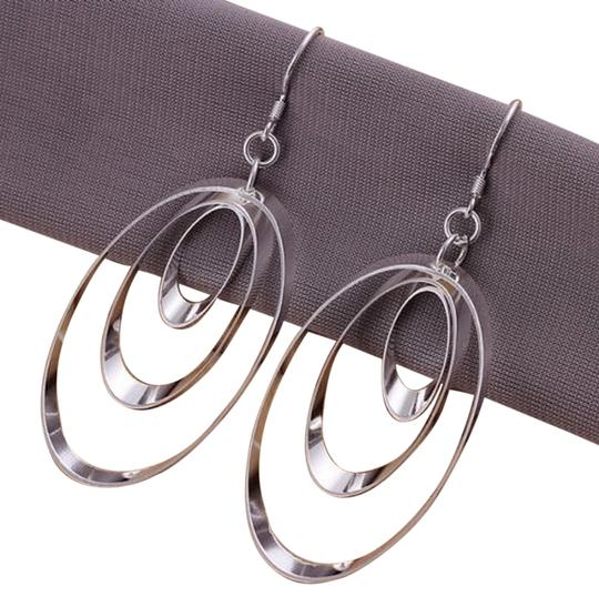 Preload https://item3.tradesy.com/images/silver-heavily-plated-3-layer-dangle-3-inches-look-great-on-everyone-earrings-1820312-0-0.jpg?width=440&height=440