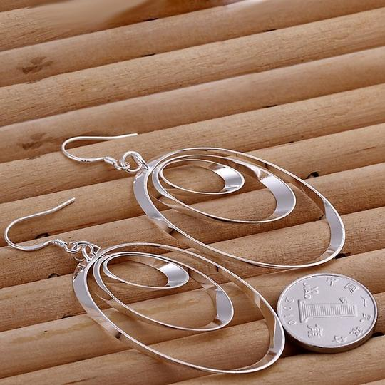 Other Heavily Silver Plated 3 Layer Earrings, Dangle 3 inches! Look Great on everyone!