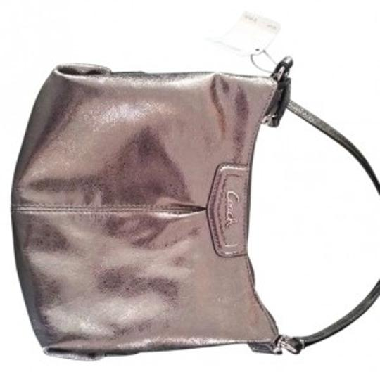Preload https://item3.tradesy.com/images/coach-ashley-swingpack-sliverpewter-f48121-svpr-silverpewter-leather-cross-body-bag-182467-0-0.jpg?width=440&height=440