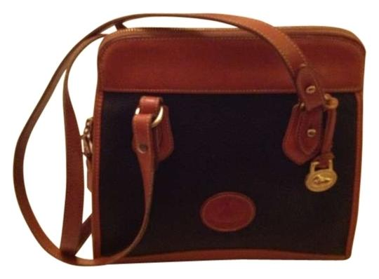 Preload https://item4.tradesy.com/images/dooney-and-bourke-r147-black-with-brown-trim-leather-shoulder-bag-182743-0-0.jpg?width=440&height=440