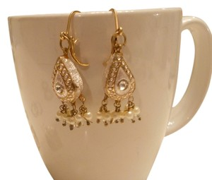 Sears Cream with Gold Dangle Dressy Earrings. I wore Them with my Mother of the Bride Dress. Very Classy!