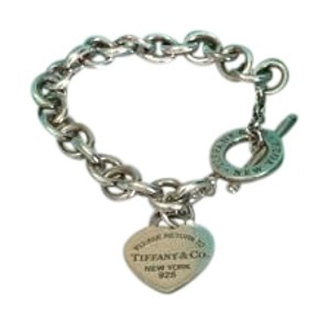 Tiffany & Co. Tiffany & Co sterling silver heart charm bracelet