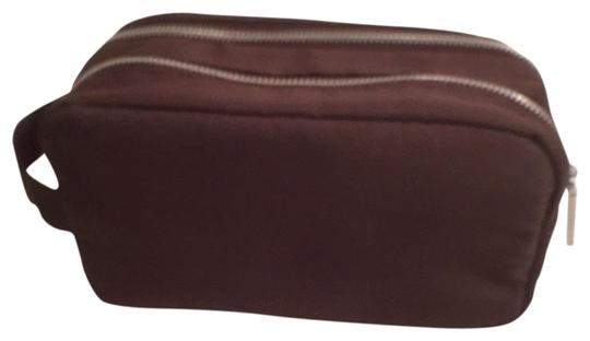 Preload https://img-static.tradesy.com/item/18382423/dolce-and-gabbana-brown-silver-polyester-canvas-cosmetic-bag-0-1-540-540.jpg