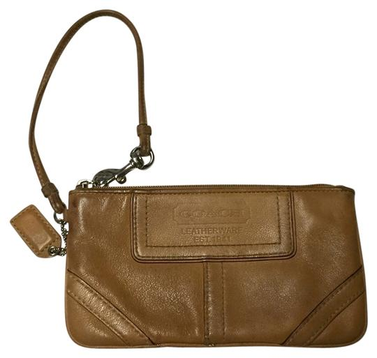 Preload https://item1.tradesy.com/images/coach-wristlet-brown-1838320-0-0.jpg?width=440&height=440