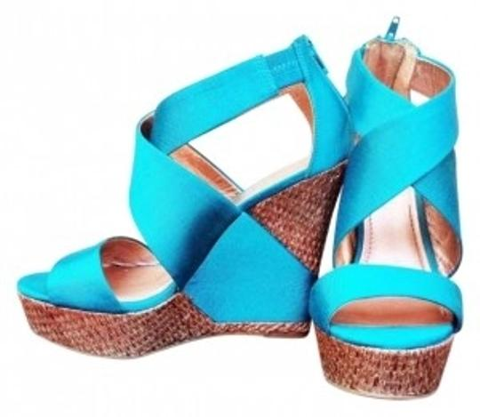 Preload https://item5.tradesy.com/images/bcbgmaxazria-teal-peacock-wedding-make-me-tall-sexy-high-something-blue-wedges-size-us-75-184084-0-0.jpg?width=440&height=440