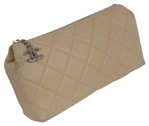 Chanel Chanel Quilted beige Lambskin makeup Bag. Almost New condition except tiny wear on corners. REDUCED!!!