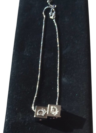 Preload https://item5.tradesy.com/images/dior-silver-christian-pendant-dice-cube-necklace-1841534-0-0.jpg?width=440&height=440
