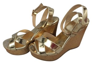 Jimmy Choo Metallic gold Wedges