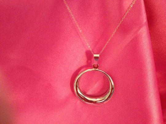 Penny's Fashion Jewelry VINTAGE Sterling Silver Filled Circular Pendant on an 18