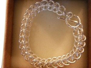 SALE!! FREE & FAST SHIPPING! NEW Sterling Silver Circles Bracelet leading to a Toggle clasp! Beautiful on! 7.5