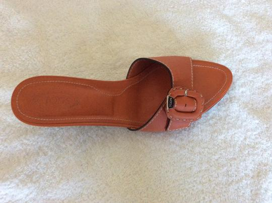 Tod's orange Mules