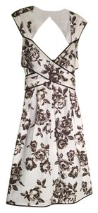 Jessica Simpson short dress Brown Floral Floral Feminine Cutout Bow on Tradesy
