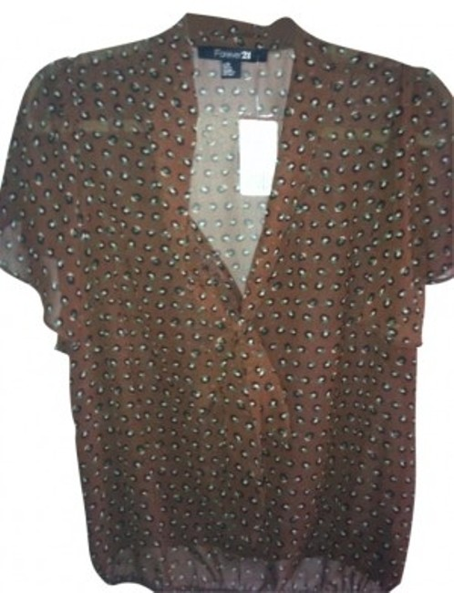 Preload https://item2.tradesy.com/images/forever-21-brown-blouse-size-12-l-184536-0-0.jpg?width=400&height=650