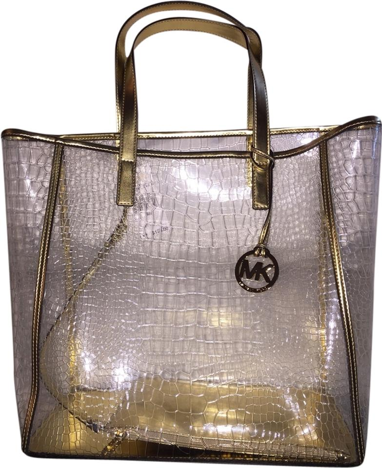 d684b4574475 Michael Kors Large Nora Clear Gold Trim Plastic Leather Tote - Tradesy