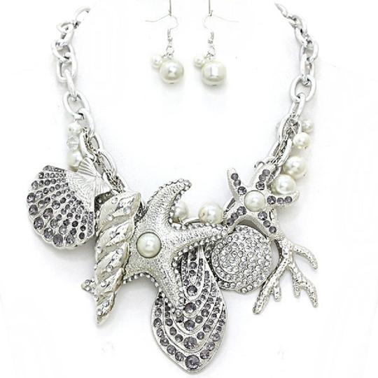 Preload https://img-static.tradesy.com/item/1848542/rhodium-pearl-clear-rhinestone-crystal-accent-starfish-and-earrings-necklace-0-0-540-540.jpg