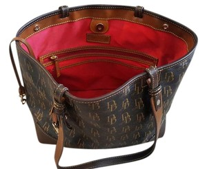 Dooney & Bourke Brown and Beige with Red inside linings Clutch