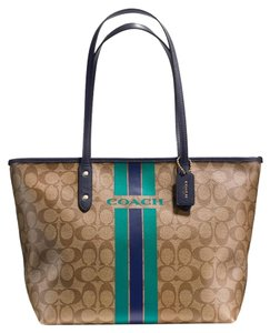 Coach Tote in Saddle, Atlantic (teal), and Navy
