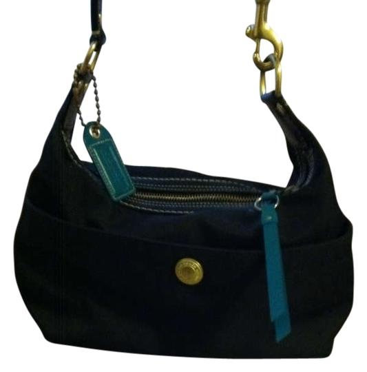 Preload https://item1.tradesy.com/images/coach-duffle-shoulder-black-and-turquoise-vinyl-shoulder-bag-185090-0-0.jpg?width=440&height=440