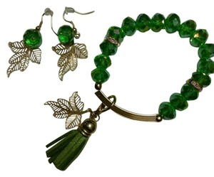 JC Creations artistic jewelry Green faceted crystal bracelet with charms and gold plated earrings!