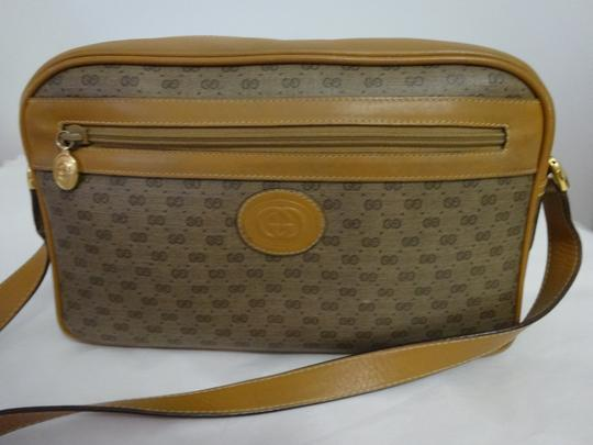 e0b4ba1c29f Gucci Logo Print Crossbody Browns Leather and Coated Canvas Shoulder ...