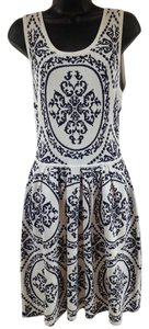 Romeo & Juliet Couture short dress White and navy Floral Zip Back Sweater on Tradesy