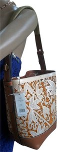 Tory Burch Dust Laser Cut Bucket Leather Tote in Parchment Floral
