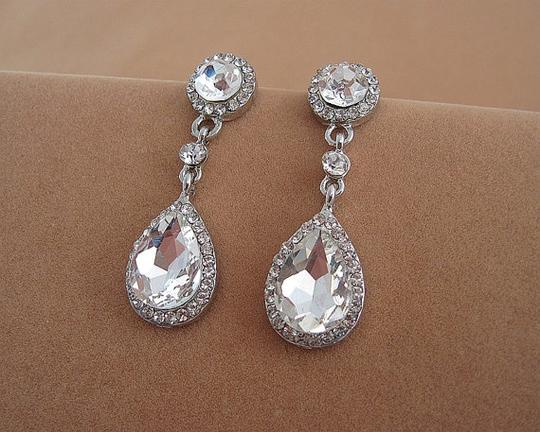 Preload https://img-static.tradesy.com/item/18540343/925-925-silver-chandelier-oval-fall-drop-silver-clear-crystal-bridesmaid-prom-pageant-earrings-0-0-540-540.jpg