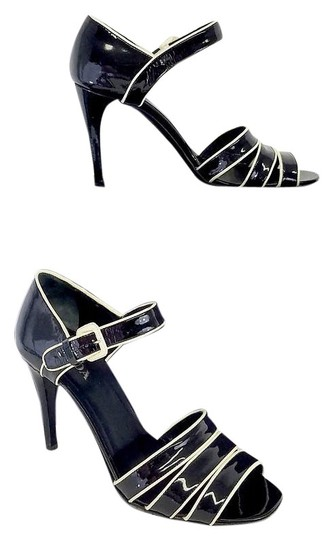 Preload https://img-static.tradesy.com/item/18548263/prada-black-and-cream-patent-leather-heels-sandals-size-us-85-regular-m-b-0-1-540-540.jpg