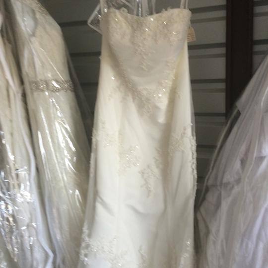 Preload https://img-static.tradesy.com/item/18555583/ivory-overlay-with-lace-formal-wedding-dress-size-12-l-0-0-540-540.jpg