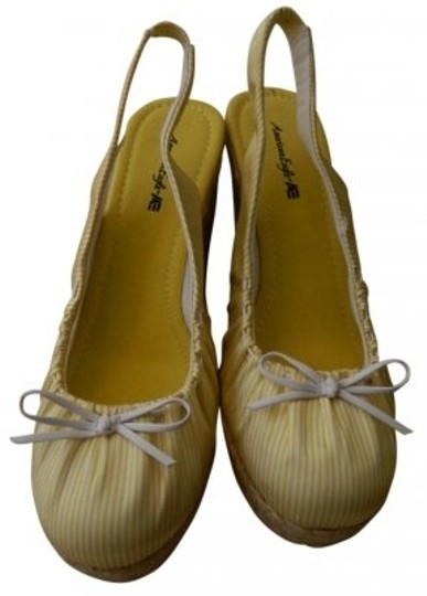 Preload https://item4.tradesy.com/images/american-eagle-outfitters-yellow-and-white-wedges-size-us-7-185843-0-0.jpg?width=440&height=440