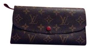 Louis Vuitton NWOT Monogram Canvas W/Red Leather Trim.