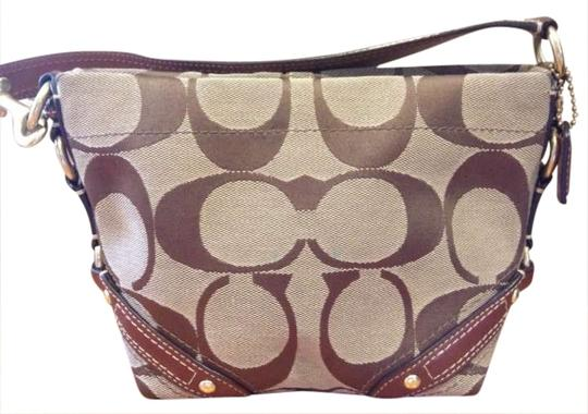 Preload https://item4.tradesy.com/images/coach-carly-top-handle-pouch-brown-signature-jacquard-fabric-shoulder-bag-186543-0-0.jpg?width=440&height=440