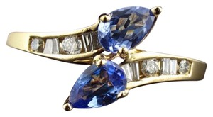 size 7.5, 14k Yellow Gold, Diamond, Tanzanite Ring