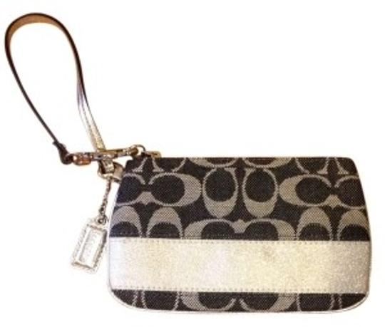 Preload https://item4.tradesy.com/images/coach-stripe-f45608-svdenimsilver-signature-fabric-with-leather-trim-wristlet-186603-0-0.jpg?width=440&height=440