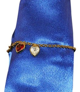 Swarovski Swarovski Crystal Studio Collection Gold Tone Bracelet W/ 2 Hearts