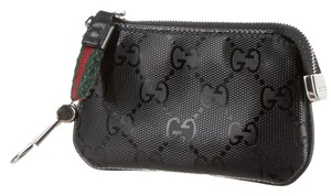 Gucci Black coated leather Gucci GG monogram key pouch
