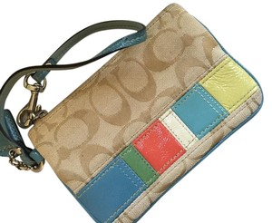 Coach Park Signature Khaki Burgundy Wristlet in Light tan with pops of color