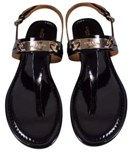 Coach Black with gold Flats